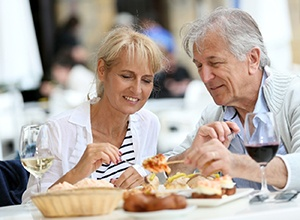 senior couple enjoying meal together at outdoor café
