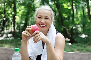 mature woman with apple