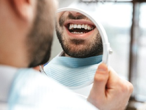 Patient admiring smile after getting tooth-colored filling in Newington