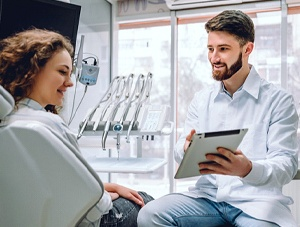 Dentist and patient discussing need for tooth-colored filling