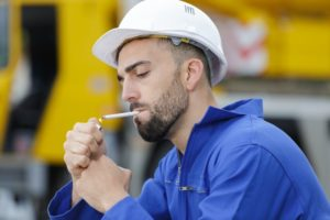 Man thinking about relationship between smoking and dental implants
